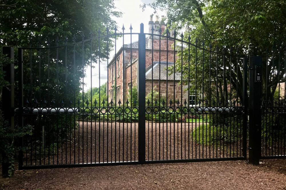 Automatic Metal Driveway Gates with matching Pedestrian Gate