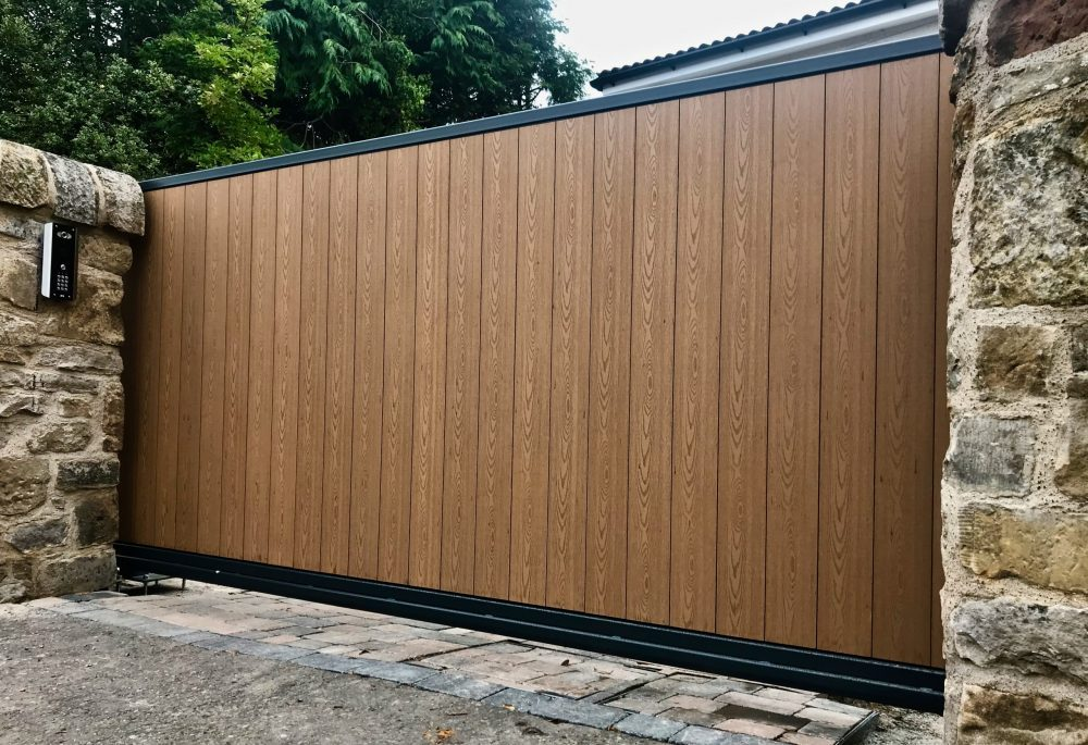 Automatic metal frame composite infill cantilever sliding gate installed in Edinburgh