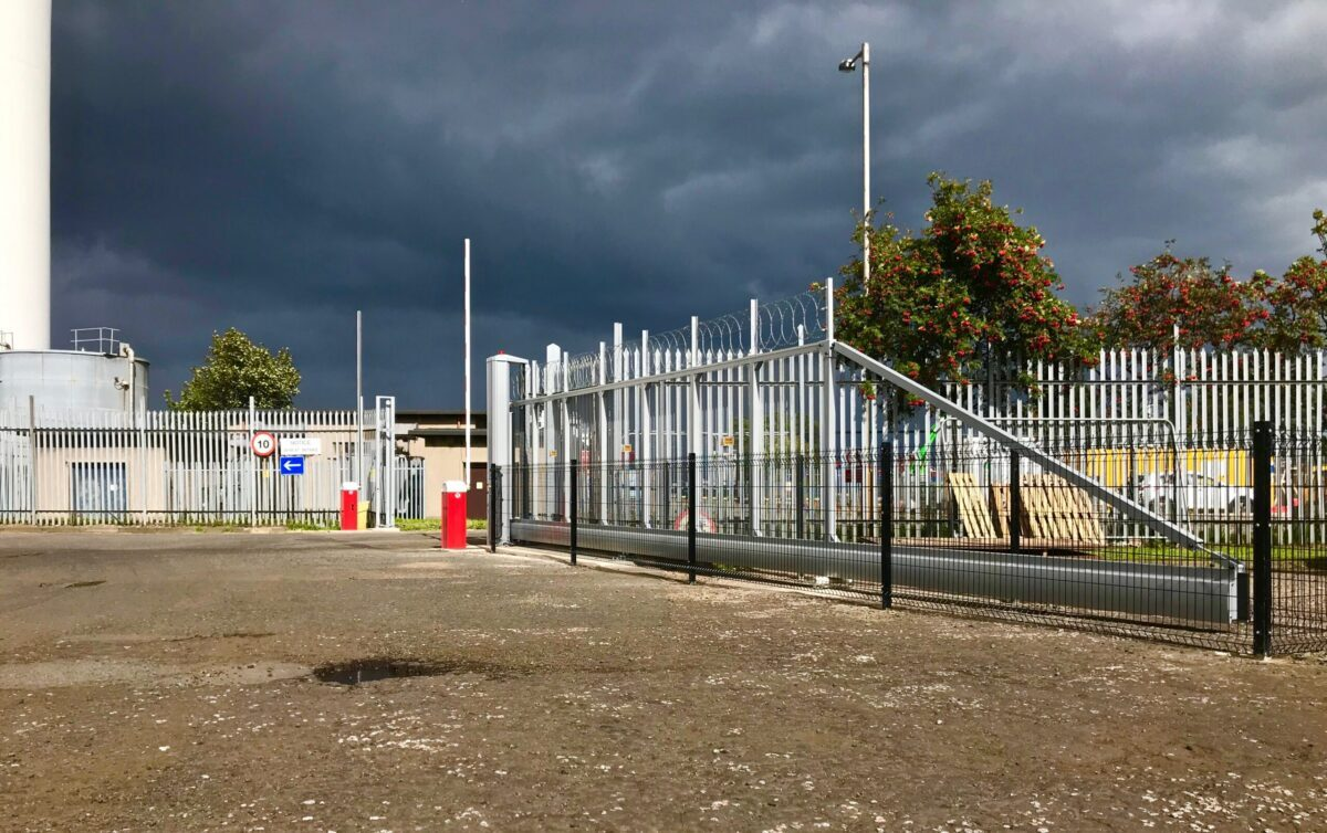AES (SCOTLAND) LTD recently installed 8m industrial automatic cantilever sliding gate with dual automatic barriers and fencing, installed in Edinburgh.