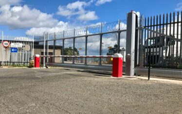 AES (SCOTLAND) LTD commercial gate, dual barriers and fencing installed for ADM Milling Edinburgh
