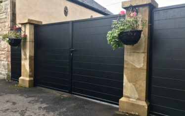 Aluminium manual driveway gates with matching side panels installed Linlithgow