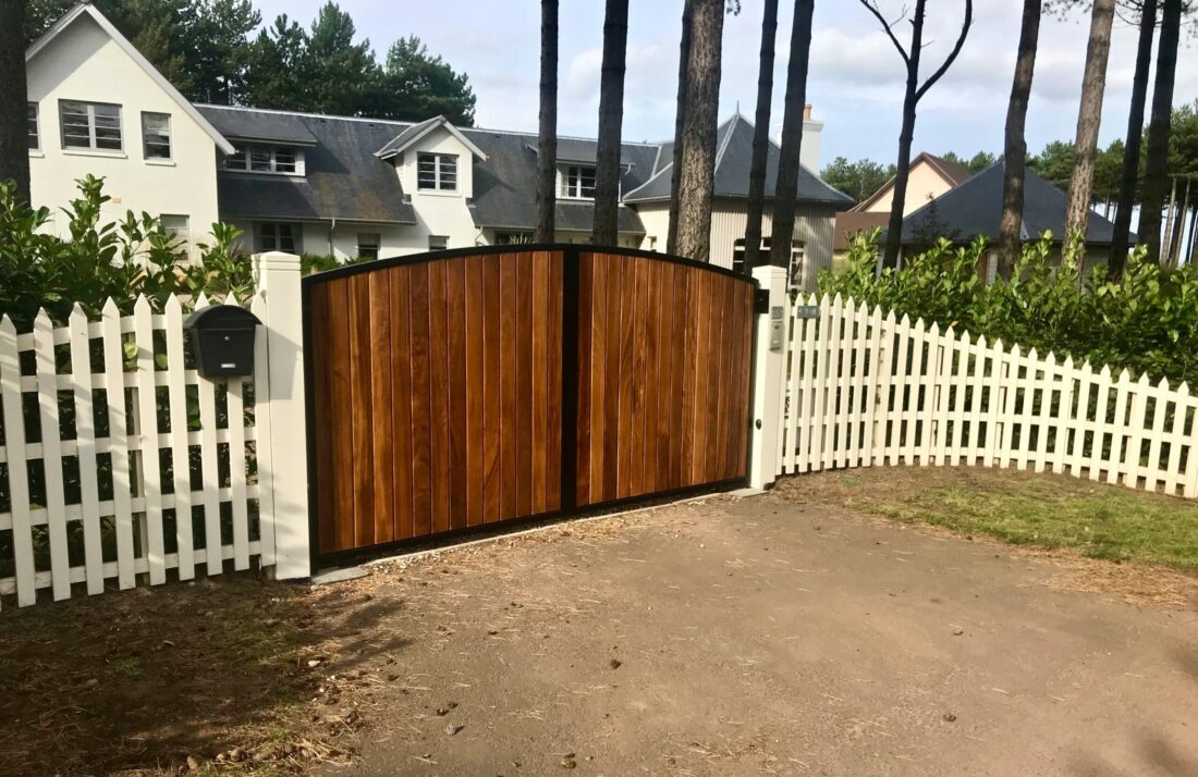 AES (SCOTLAND) LTD new automatic metal framed Iroko clad driveway gates, installed in King's Cairn at Archerfield.