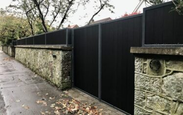 AES (SCOTLAND) LTD recently installed automatic and manual composite driveway gates with matching wall top panels Edinburgh.