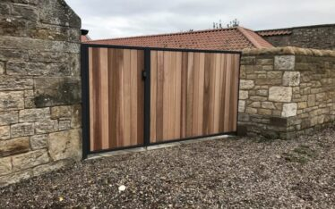 Metal framed cedar infill driveway gate installed in St Andrews Fife