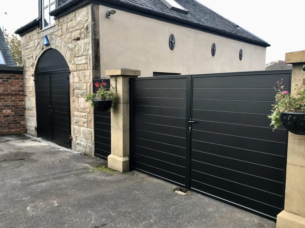 AES (SCOTLAND) LTD recently installed aluminium garage doors to match previously installed driveway gates in RAL9005 - Jet Black.