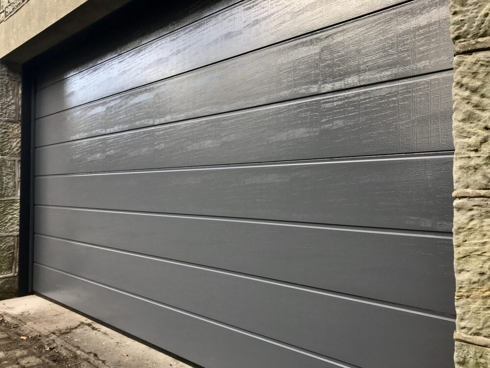 AES (SCOTLAND) LTD recently installed automatic insulated sectional garage door in RAL7015 - Slate Grey.