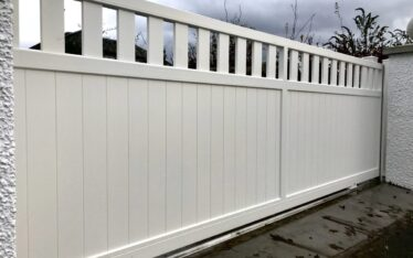AES (SCOTLAND) LTD newly installed aluminium automatic sliding driveway gate with matching pedestrian gate in RAL9010.