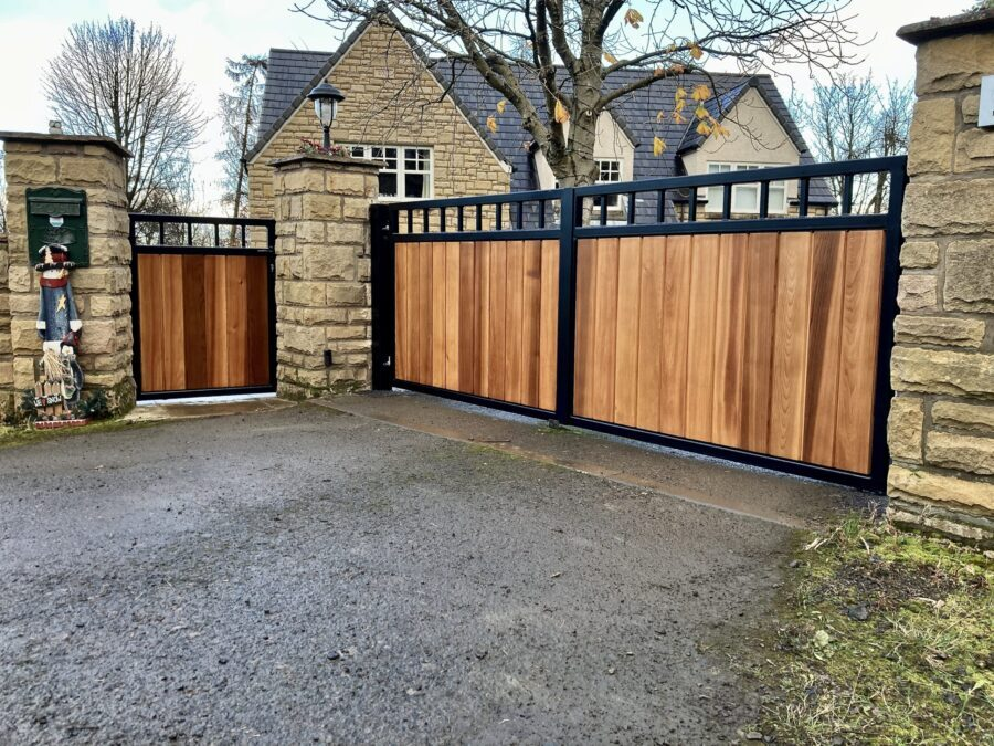 AES (SCOTLAND) LTD recently installed metal framed wooden gates with matching pedestrian gate Edinburgh