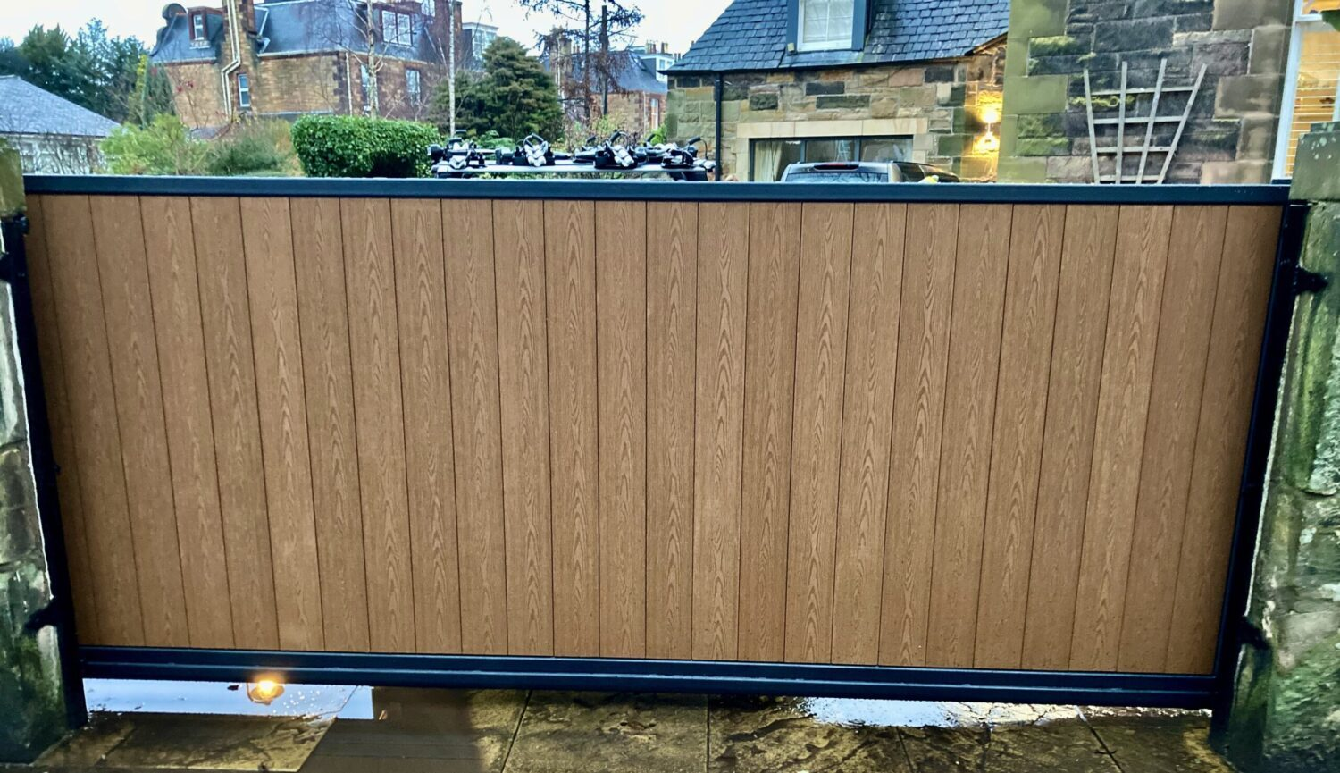 AES (SCOTLAND) LTD recently installed automatic metal framed composite infill sliding gate in Edinburgh