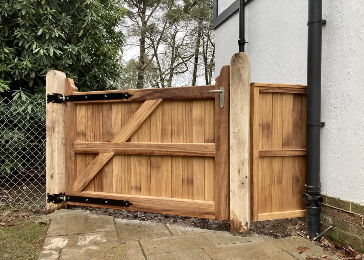 AES (SCOTLAND) LTD recently installed Iroko pedestrian gate with matching side panel, hung from Oak posts in Edinburgh.