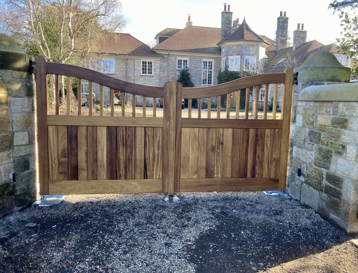 AES (SCOTLAND) LTD newly installed Iroko driveway gates, using client's existing automation. ‍‍‍‍‍‍