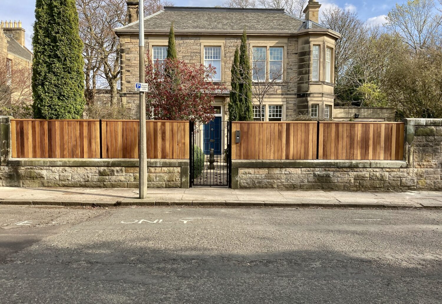 AES (SCOTLAND) LTD recently installed solid iroko cantilever sliding gate with matching fence panels in Edinburgh