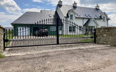 AES (SCOTLAND) LTD recently installed automatic wrought iron driveway gates with matching pedestrian gate in Perth.