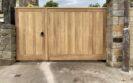 AES (SCOTLAND) LTD recently installed manual solid Iroko wooden driveway gates in Edinburgh.  