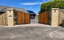 AES (SCOTLAND) LTD recently installed automatic metal framed Iroko driveway gates in Perth.  